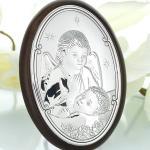 Anioł Stróż czuwający nad dzieckiem
