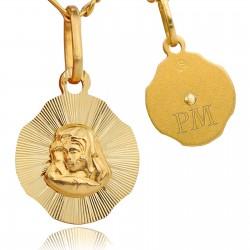 złoty medalik z grawerem na pamiątkę komunijną